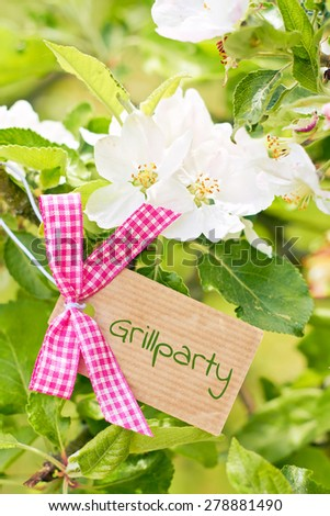 bautiful apple tree blossom greeting card background - german for barbecue - stock photo
