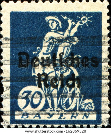 "BAVARIA - CIRCA 1920: A stamp printed in Bavaria with a ""Deutsches Reich"" overprint shows an allegory of electricity, harnessing light to a water wheel, circa 1920"