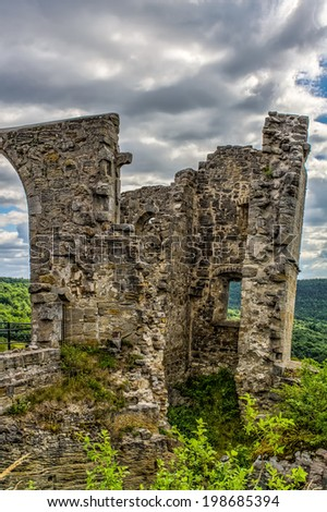 Bavarian Castle Ruin Altenstein in german Franconia. Medieval Romantic Ruins of Germany. Cloudy Blue Summer Sky. Old stone Building, covered with grass