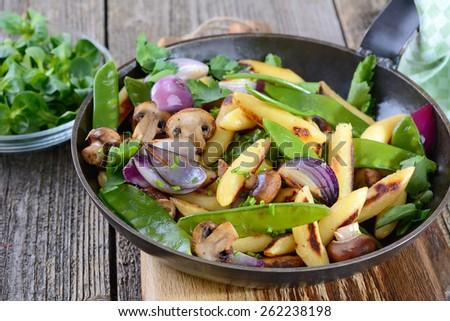 Bavarian fried finger-shaped potato dumplings with vegetable - stock photo