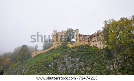 Bavarian Hohenschwangau Castle in the foggy autumn day, Germany