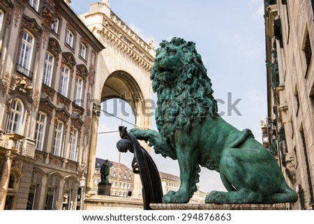 Bavarian lion statue at Munich Alte Residenz palace in Odeonplatz. Munich, Bavaria, Germany. Munich is the capital and largest city of the German state of Bavaria