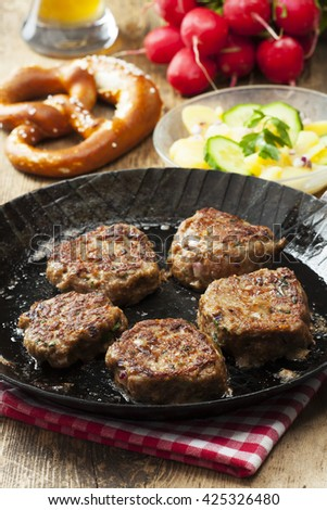 bavarian meatballs in a pan  - stock photo
