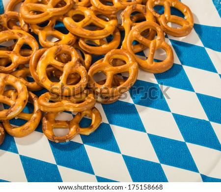Bavarian Pretzels on a white-blue plate - stock photo