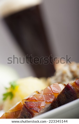 bavarian roasted pork and beer  - stock photo