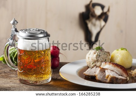 bavarian roasted pork with beer  - stock photo
