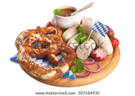Bavarian veal sausage breakfast with sausages, soft pretzel and mild mustard on wooden board from Germany - stock photo