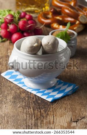 bavarian white sausage in a white pot  - stock photo