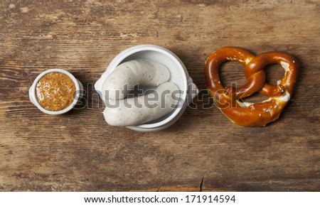 bavarian white sausages with pretzel  - stock photo