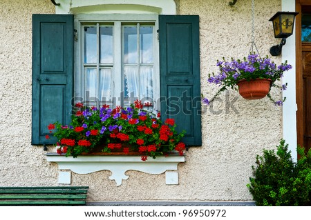 Bavarian Window with Open Wooden Shutters, Decorated With Fresh Flowers - stock photo