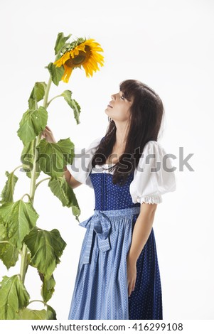 bavarian woman and a sunflower