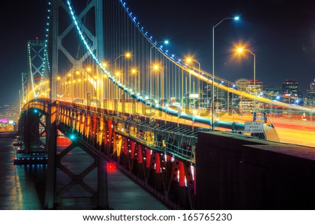 Bay Bridge perspective at night. San Francisco, California. - stock photo