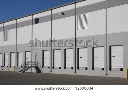 Bay doors in a warehouse - stock photo