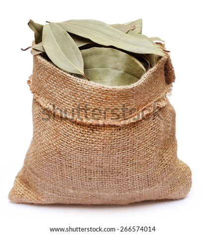 Bay leaves in sack bag over white background - stock photo
