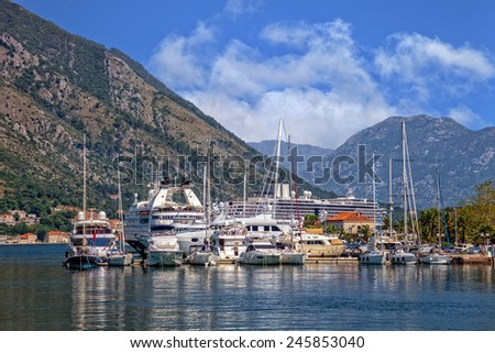 Bay of Boka Kotorska with pier and boats in Kotor, Montenegro.