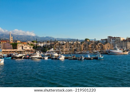 bay of Chania with historical houses and boats at sunny summer day, Crete, Greece - stock photo