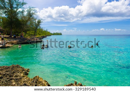 BAY OF PIGS, CUBA - SEPTEMBER 9, 2015:  Tourist attraction for swimming in Cueva de los Peces,  seaside cave with tropical fish.