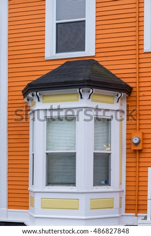 Bay window on orange building