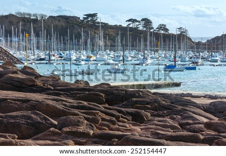 Bay with sailboats. The Cote de granite rose (or Pink Granite Coast) in Brittany, France. Spring view.