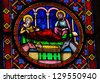 BAYEUX - FEBRUARY 12: Stained Glass window depicting a Nativity Scene, in Bayeux, Calvados, France on February 12, 2013. - stock photo