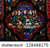 BAYEUX - FEBRUARY 12: Stained glass window depicting Jesus and his disciples at the Last Supper on Maundy Thursday, in the cathedral of Bayeux, Normandy, France  on February 12, 2013. - stock photo