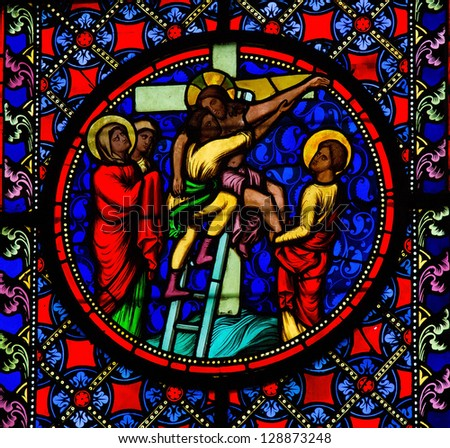 BAYEUX - FEBRUARY 12: Stained Glass window depicting Jesus taken from the cross, in Bayeux, Calvados, France on February 12, 2013. - stock photo