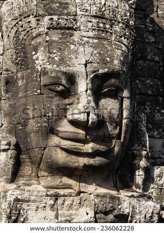 Bayon, huge stone faces of the bodhisattva Avalokiteshvara, Cambodia - stock photo