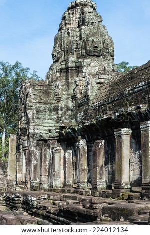Bayon, Khmer temple at Angkor in Cambodia. Official state temple of the Mahayana Buddhist King Jayavarman VII - stock photo