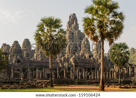 Bayon, one of the best known and most impressive temples of the archaeological site of Angkor  in Cambodia, in the light of the rising sun - stock photo