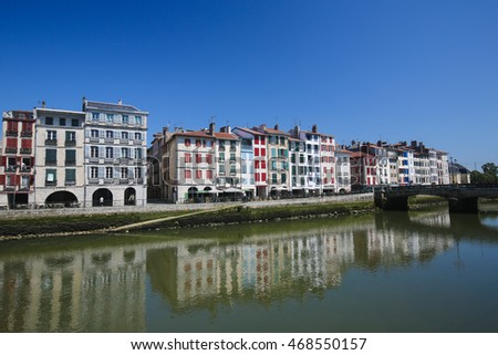 BAYONNE, FRANCE - JULY , 2016: Old houses by the river La Nive in the center of Bayonne, a city in the Aquitaine region of south-western France.
