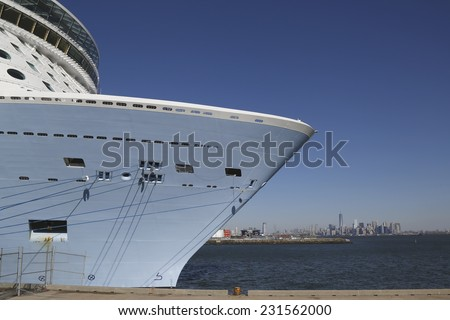 BAYONNE, NEW JERSEY - NOVEMBER 18: Newest Royal Caribbean Cruise Ship Quantum of the Seas docked at Cape Liberty Cruise Port with the view of Manhattan  before inaugural voyage on November 18, 2014 - stock photo