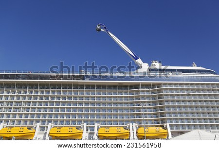 "BAYONNE, NEW JERSEY - NOVEMBER 18: The ""NorthStar"" observation tower at the  newest Royal Caribbean Cruise Ship Quantum of the Seas docked at Cape Liberty Cruise Port on November 18, 2014.  - stock photo"