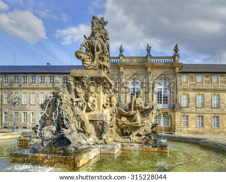Bayreuth - Fountain and New Palace (Neues Schloss), seat of the margraves from 1753. Bayreuth is famous for its annual festival for operas of Richard Wagner. - stock photo