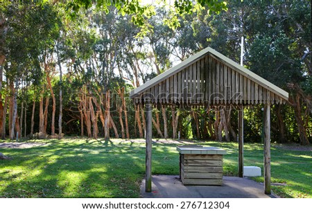 bbq area surrounded by grass and trees, queensland, australia - stock photo