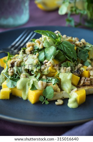 BBQ chicken breast mango and watercress salad with green goddess dressing - stock photo