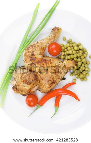 bbq : chicken ham garnished with green onion pens and red chili hot pepper on white plate isolated over white background - stock photo
