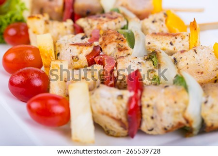 BBQ chicken on a white plate - stock photo