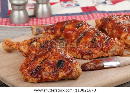 Bbq chicken quarters on a cutting board
