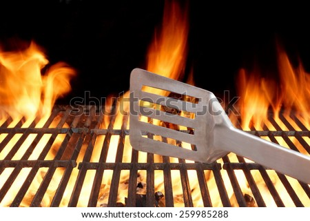 BBQ Grill And Spatula. Flame Of Fire In The Background. You can see more BBQ Grill Party Picnic Scene in my set. - stock photo