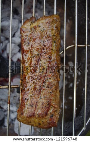BBQ meat on open griddle with close up - stock photo