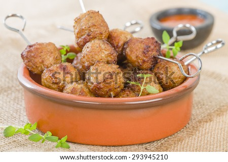 BBQ Meatballs - Meatballs on metal skewers served with chilli dip. - stock photo