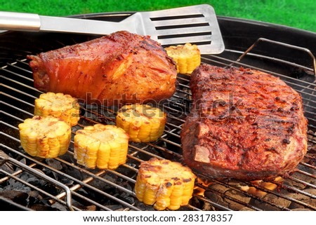 BBQ Pork Knuckle,  Marinated Spareribs and Spatula On The Hot Flaming Charcoal Grill