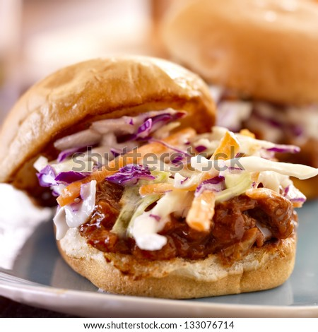 bbq pulled pork sandwich close up with cole slaw - stock photo
