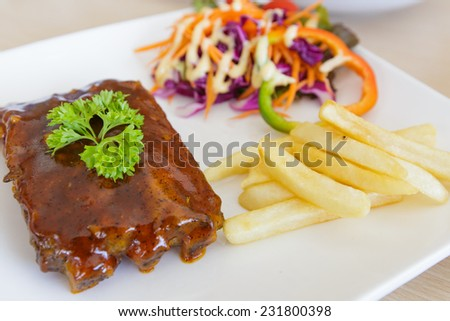 BBQ ribs with french fries - stock photo