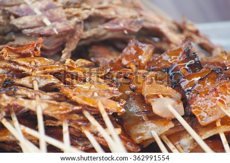 BBQ Seafood, Dried Squid grilled with skewer at a street shop along the shore in Thailand  - stock photo
