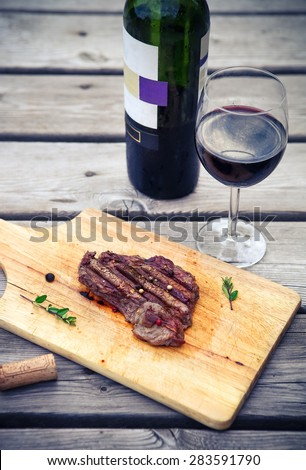 BBQ steak. Barbecue grilled beef steak meat with red wine. Healthy food. Barbeque steak dinner - stock photo