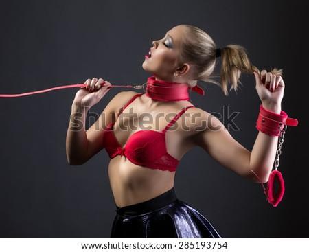 BDSM. Image of beautiful glamorous girl on leash - stock photo