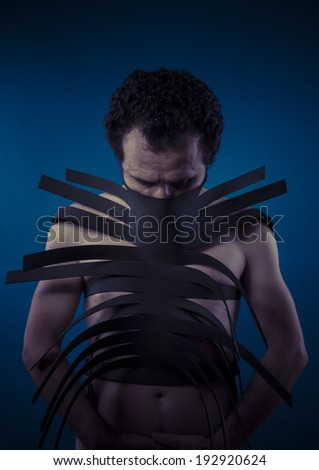 Bdsm, man covered with black strips, shibari concept art - stock photo