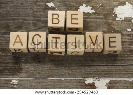 be active text on a wooden background - stock photo