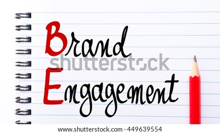 BE Brand Engagement written on notebook page with red pencil on the right